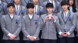 Produce 101: Dư luận bất bình khi fan quốc tế gửi vòng hoa gạo đến ủng hộ NU'EST